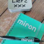 Notitieboekje en pen met naam